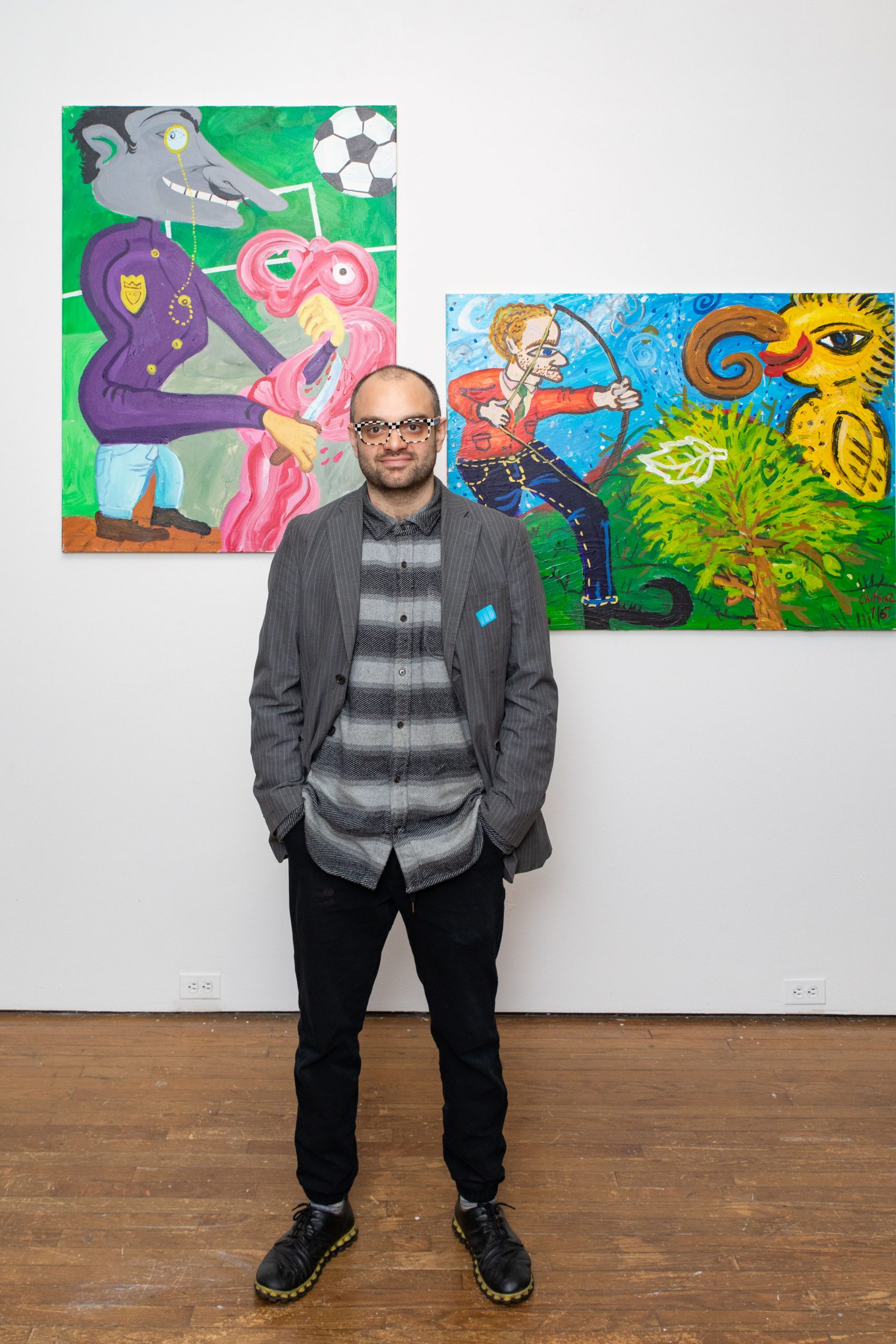 "Ali Chitsaz with his work, ""The Party of Doom"""
