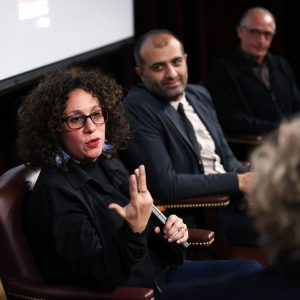 "Panelists Sara Nodjoumi, Reza Mazaheri, and Hadi Ghaemi, at screening of ""When God Sleeps"" moderated by Thane Rosenbaum. Tishman Auditorium, NYU School of Law, March 2018. Photography by Bruce Gilbert."